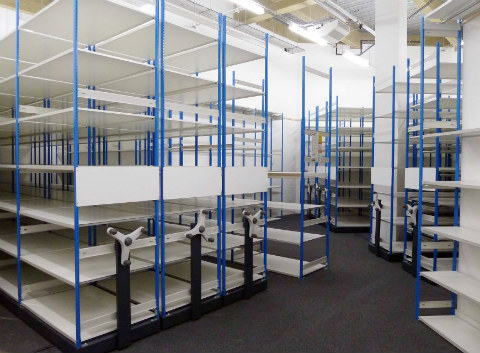 Movable Shelving Racks In a Stockroom Ready For Loading