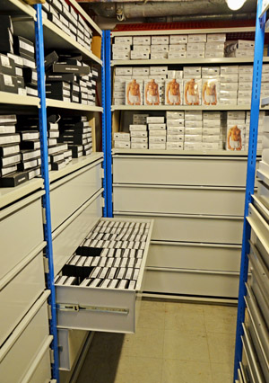 Steel storage drawers within shelving units