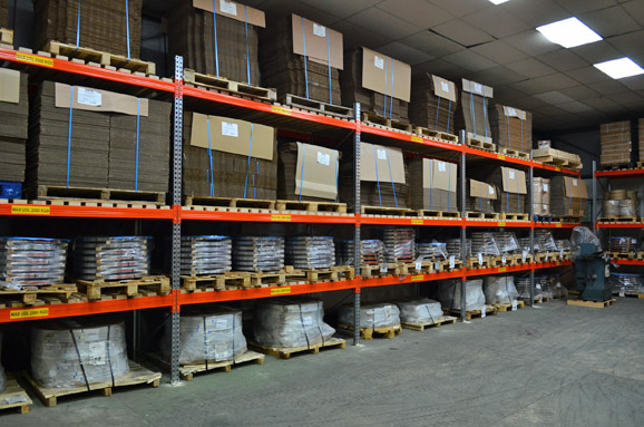 Pallets of cardboard boxes stored on racking