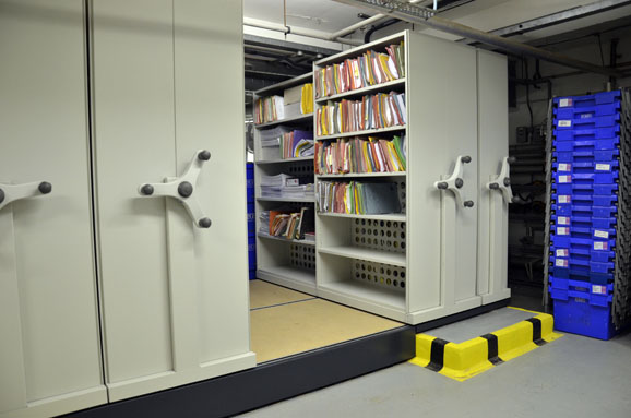 Movable shelves for compact filing