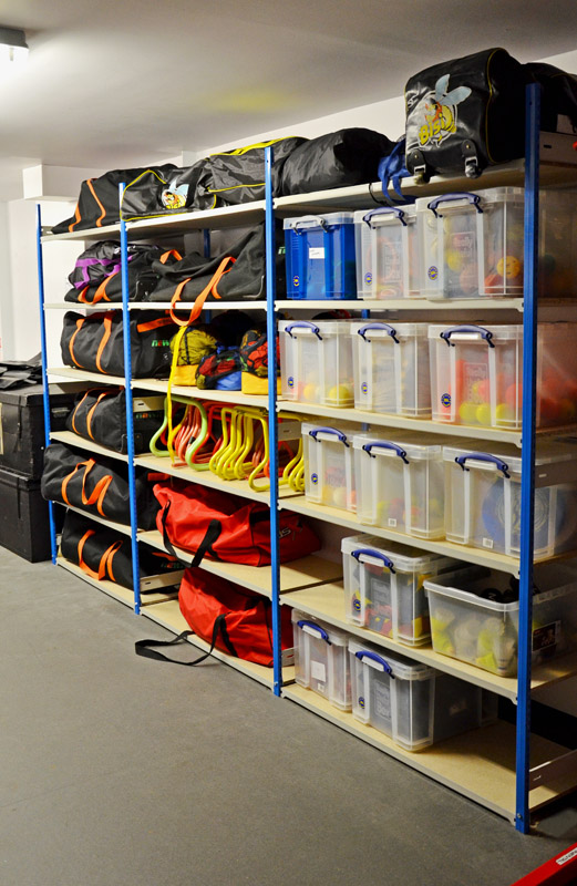 Storage Shelving With Sports Bags And Really Useful Boxes
