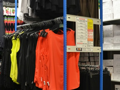 Safety load sign attached to garment racking