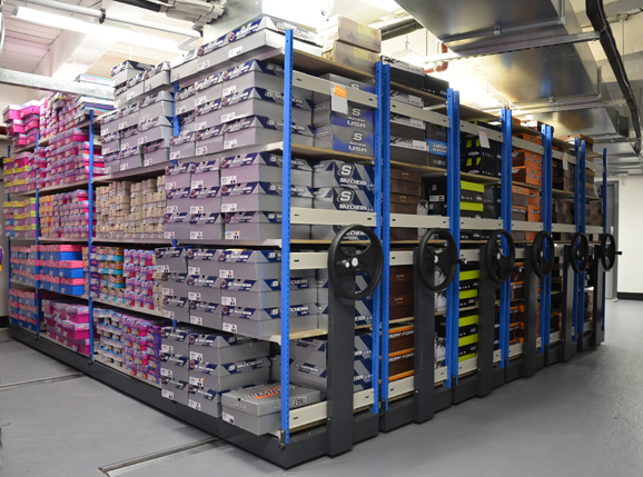 Shoe Box Shelving Mounted On Roller Racking Bases
