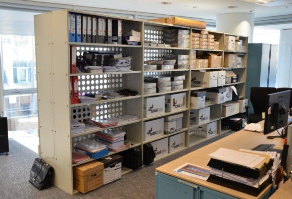Office shelving with perforated back panels