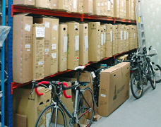 Warehouse storage racking for boxed, unassembled bicycles