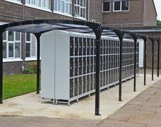 Outside school lockers under a free-standing canopy