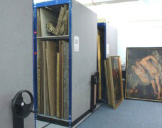 See how artwork can be stored using mobile picture racking