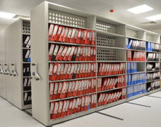 Lever Arch Files Housed Within Mobile Shelving Bays