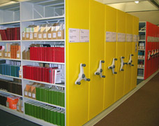 Colourful mobile shelving bays