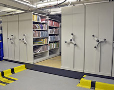 Movable shelving units that bridge a floor gap