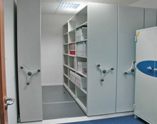 Compact roller shelving in small office corner