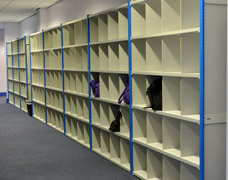 Long runs of pigeon hole shelving